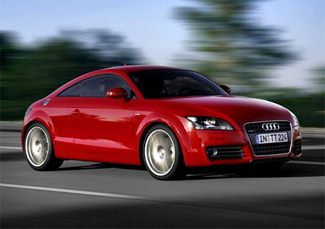 Audi Tt Red. A red Audi drives by and